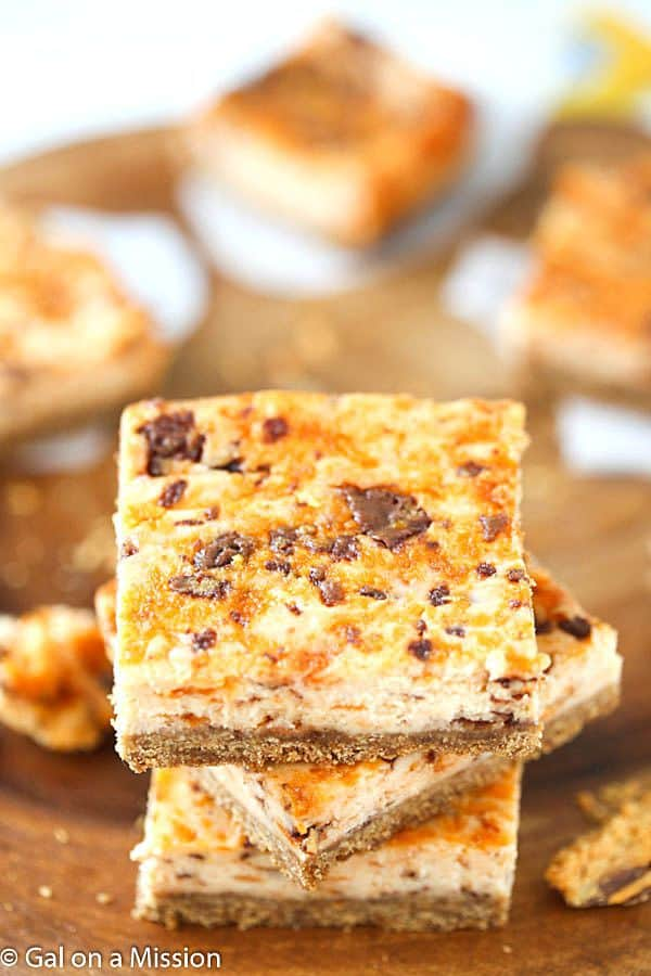 Butterfinger Cheesecake Bars – A crunchy graham cracker crust, then layered with an outrageous, creamy cheesecake mixed with chopped up butterfingers!