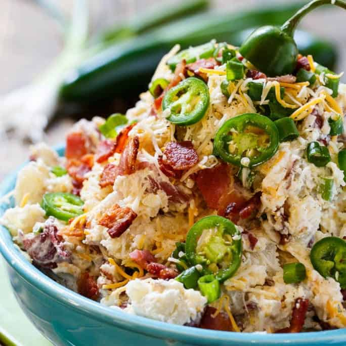 Jalapeno Popper Potato Salad, made with cream cheese, bacon, and lots of jalapeno peppers, is a spicy and delicious twist on regular potato salad that is just what you need to heat up your next cookout or picnic.