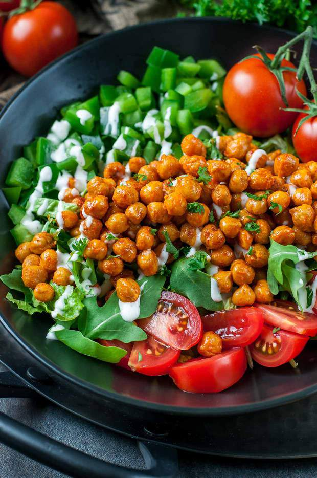 Buffalo-sauced eats don't have to be unhealthy and salads can be anything but boring! This Buffalo Chickpea Salad is super easy to make, loaded with veggies, and delivers a much needed high-five to the tastebuds. Try it today!