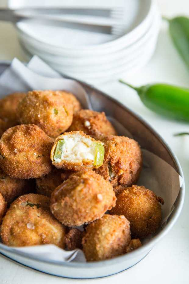 These Jalapeno Poppers are the best of all worlds: Spicy peppers, creamy filling, crunchy outside, and bite-sized packaging! Everything you want on your next party platter.