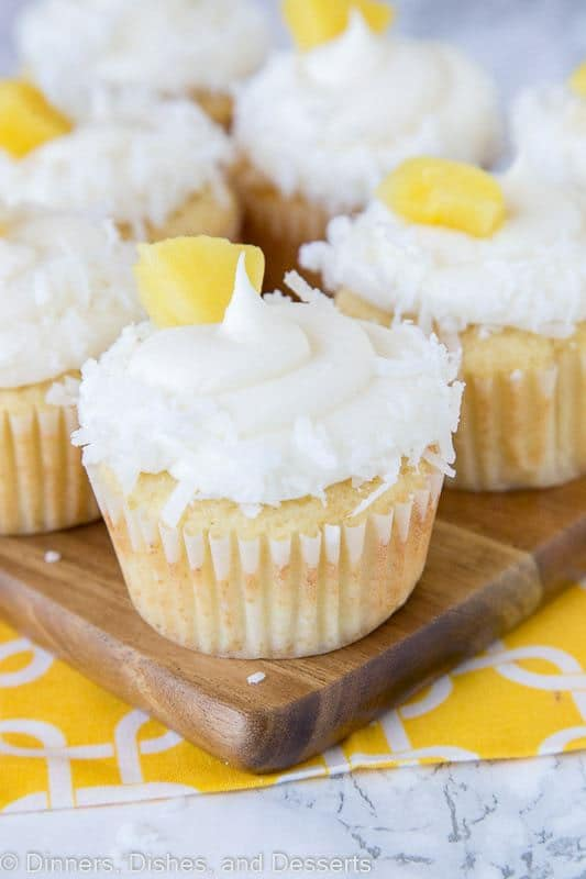 ineapple Coconut Cupcakes- A moist and tender homemade cupcake that tastes like the tropics! Pineapple and coconut flavor the cupcakes and the frosting!