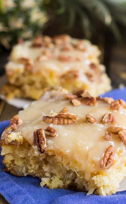 Pineapple Sheet Cake flavored and moistened with crushed pineapple and topped with a sweet icing laced with shredded coconut, and sprinkled with pecans is a wonderful dessert to make to feed a crowd.