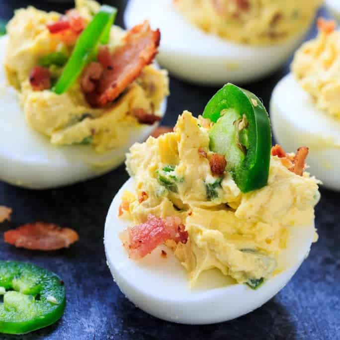 Jalapeno Popper Deviled Eggs are flavored with cream cheese, jalapenos, and bacon and make a fantastic appetizer for Easter.