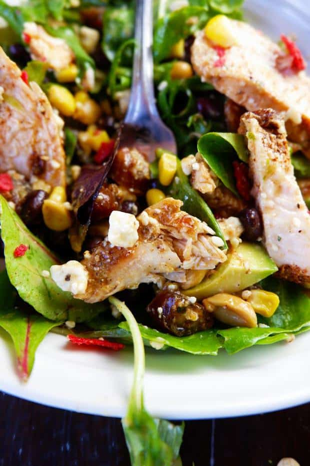 Inspired by the Earl's menu, this healthy salad recipe grilled blackened chicken, feta, peanuts, dates, tortilla strips, avocado, and topped with a peanut lime vinaigrette.