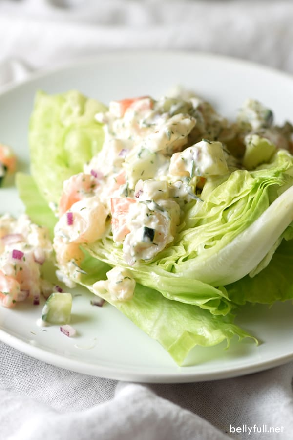 Creamy Shrimp and Dill Wedge Salad – a creamy shrimp and dill mixture sit on top of crisp, fresh lettuce. This salad is layered with flavor, refreshing, and super easy to make!