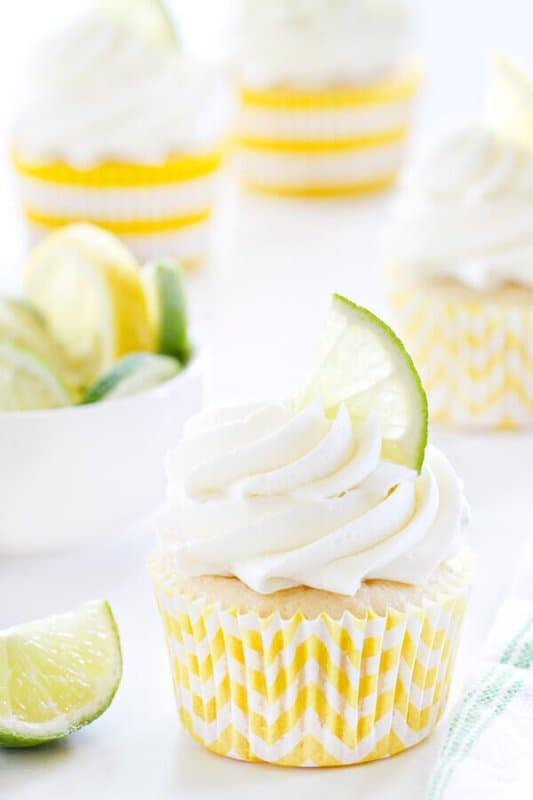 A layer of pineapple tucked in the middle with a cherry surprise at the bottom all topped with a cream cheese frosting.  Bring a little taste of the tropics with these Pineapple Cupcakes!
