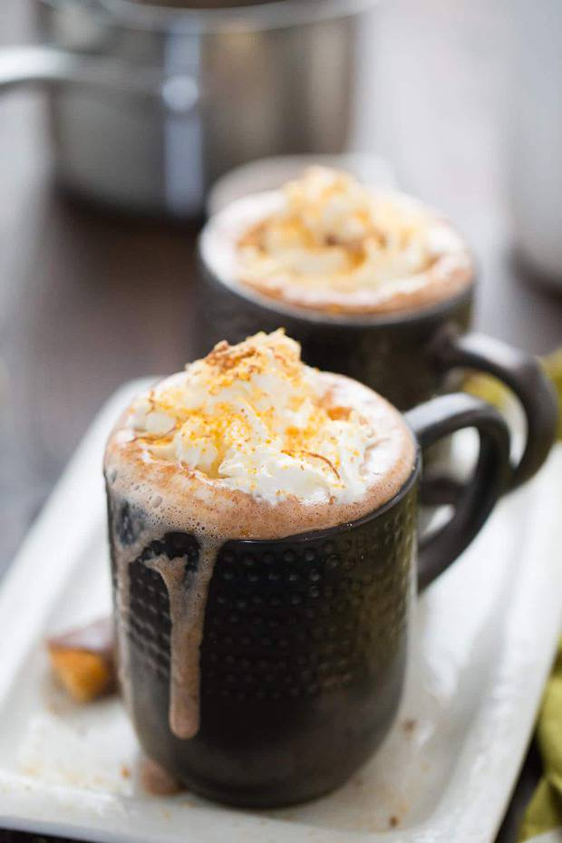 A lusciously rich and smooth hot cocoa recipe that tastes like Butterfinger candies.  Oh, and did I mention the booze