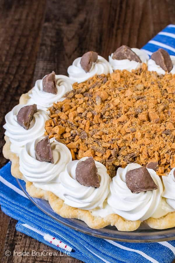 The creamy and crunchy layers in this Peanut Butter Butterfinger Pie will have you going back for more.  It is a decadent and easy dessert to make for the holidays.