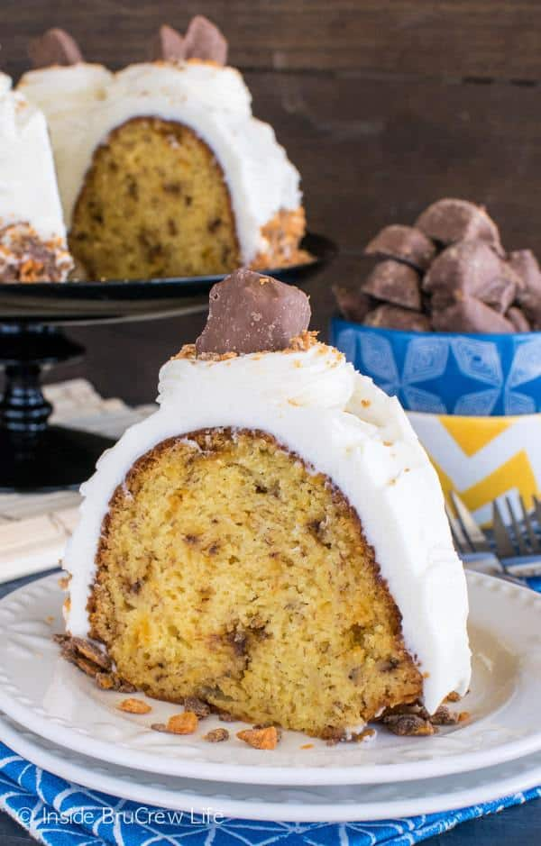Swirls of Butterfinger candy bits and cream cheese frosting add a fun twist to this easy Banana Butterfinger Bundt Cake. It's a great way to use up those ripe bananas on the counter.