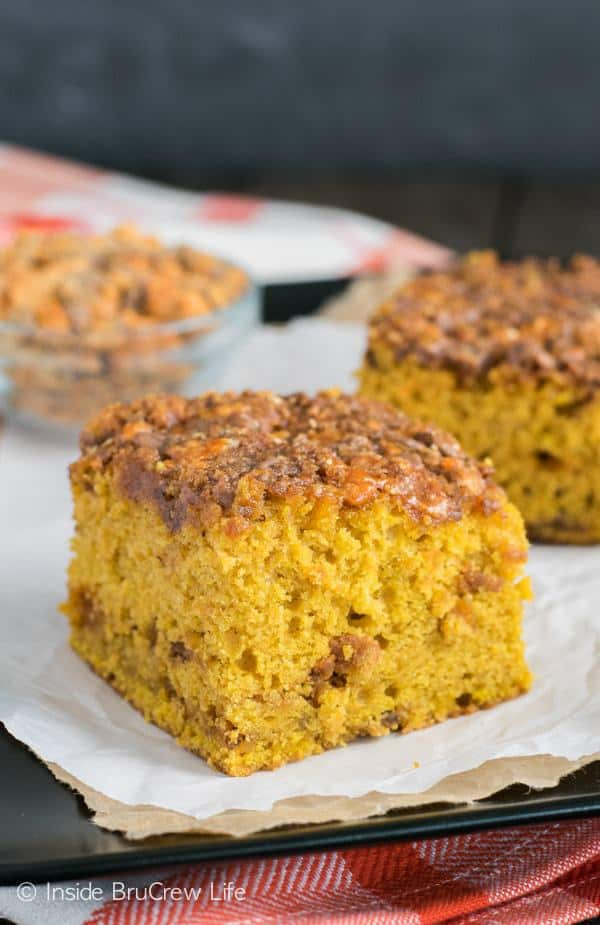 PThis soft cake has a gooey candy topping making it completely irresistible.  I'm sure this Pumpkin Butterfinger Cake will become your new favorite fall dessert.