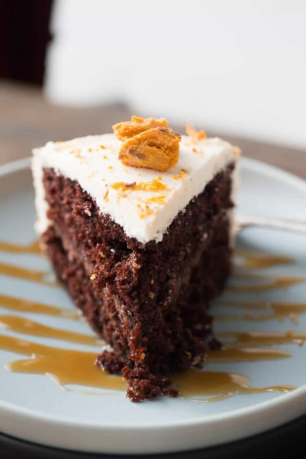 BThis Butterfinger cake is two layers of decadence! A rich chocolate cake is layered and filled with chocolate ganache and topped with Buttercream and Butterfingers!