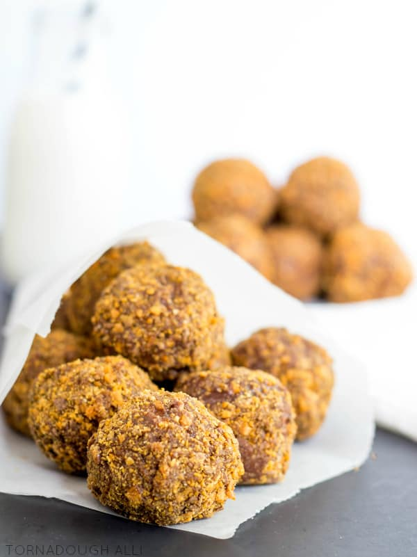 Decadent cake donuts dipped in creamy chocolate poured glaze and coated with delicious crushed Butterfinger bites make these Butterfinger Donut Holes a great popable treat!