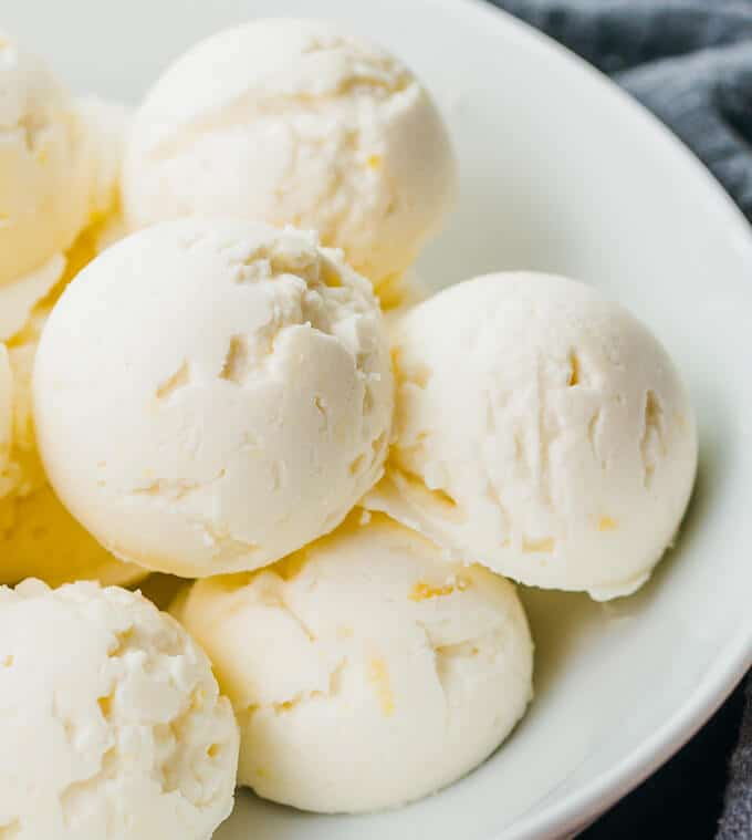 These lemon cheesecake fat bombs are snack-sized frozen treats made with cream cheese, butter, lemon juice, and a sugar-free sweetener. Keto, low carb, and gluten free.