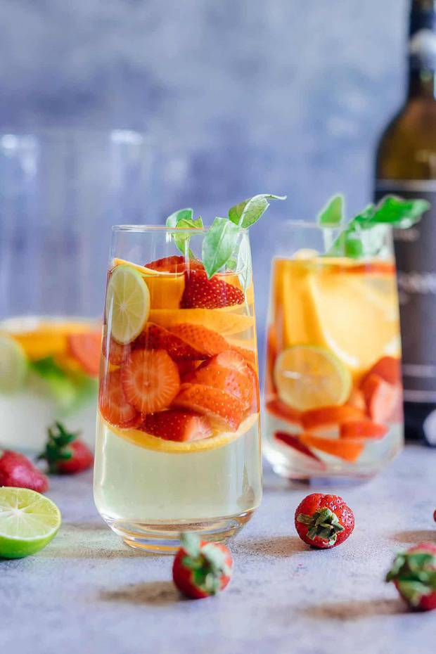 Strawberry Orange White Wine Sangria is a refreshing cocktail that combines the sweetness and flavours of strawberries, oranges, limes and basil with white wine for a fresh take on a traditional sangria. It's the perfect brunch drink that can be made ahead for a crowd.