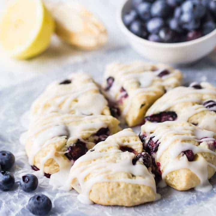 Celebrate summer with lemon blueberry scones! Easy to make, moist, and just bursting with sweet, seasonal fruit. You'll love this quick scone recipe.
