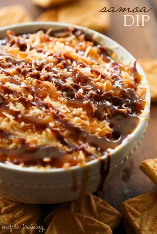 This Samoa Dip is sweet and addicting. Creamy caramel base, topped with toasted coconut and drizzled with additional caramel and chocolate- I could faint of sheer happiness. Dip some Shortbread Cookies (like Lorna Doones) into it and you are in a Samoa Cookie inspired heaven. Everything I love enveloped in on amazing recipe, and it whips up in no It is as beautiful as it is delicious.