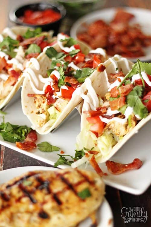Grilled Chicken BLT Tacos are a delicious fusion of two of our favorite Summer dishes. The bacon flavor in each bite takes chicken tacos to a new level!