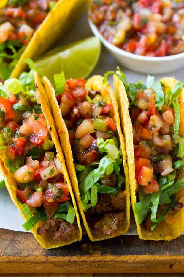 These Oven Baked Beef Tacos are filled with beans, meat and melted cheese. then topped off with shredded lettuce and fresh salsa. The best way to make taco's for a crowd!