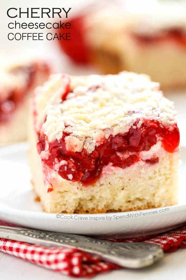 Cherry Cheesecake Coffee Cake is a total dream dessert!  Cheesecake is one of my all time favorites and the first dessert I always choose.  There's just something magical about that rich creamy base topped with a sweet tart cherry pie filling.  This recipe adds in a delicious buttery coffee cake base under layers of cherry cheesecake and a little bit of streusel topping for a real taste of heaven!