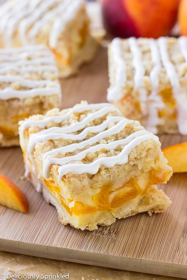 These peaches and cream bars have a thick buttery bottom layer covered with a sweet peach filling and topped with the BEST buttery crumble topping. Seriously, these bars are a super addicting and as always, super simple to make. Drizzle each bar with vanilla glaze or/and serve with a scoop of vanilla ice cream, either way I know your going to love them!