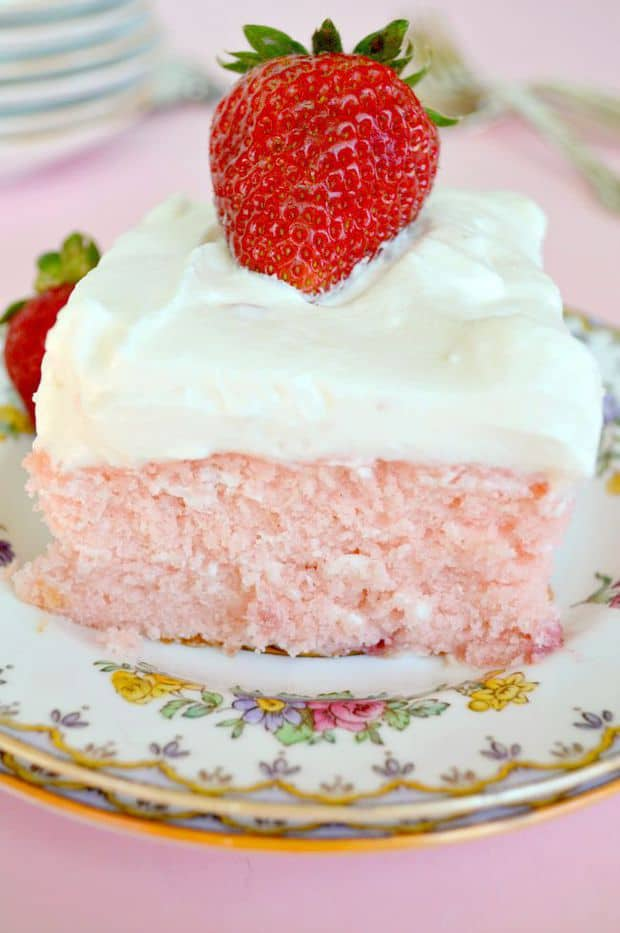 The BEST Strawberry Sheet Cake Ever. Tender, moist cake loaded with fresh strawberries then topped with a to-die-for Lemon Cream Cheese to-die-for frosting! Bring this cake to the next potluck and you'll be the Belle of Baked Goods!