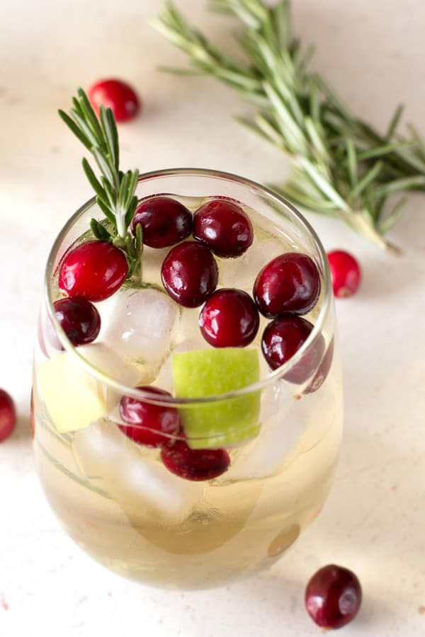 Christmas Sangria is a delightful way to celebrate the holidays, all in one gorgeous chilled glass. This festive sangria is just the right balance of crisp and fruity, with a slight touch of sweetness!