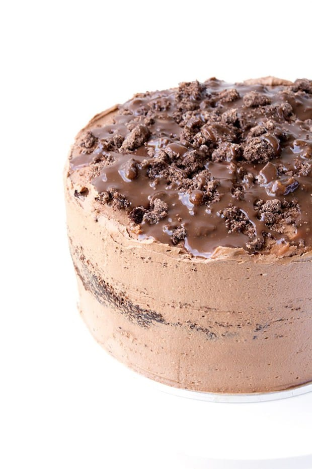 This Death By Chocolate Layer Cake is the cake of your dreams. Three gorgeous layers of chocolate cake with a chocolate milk soak, chocolate cookie crumbs, creamy chocolate buttercream and milk chocolate ganache.