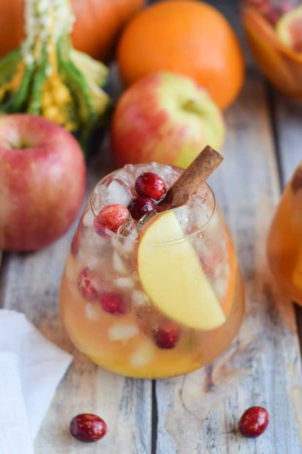 Pumpkin Apple Sangria is bursting with fall flavors. Sweet, spicy and full of wine soaked fruit, it's sure to be a hit at all your fall celebrations.