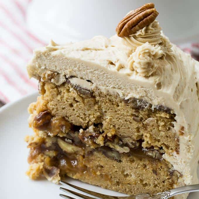 Pecan Pie Layer Cake is a showstopper dessert for the holidays. A thick layer of pecan pie filling is sandwiched between two layers of brown sugar cake and the whole thing is covered in lots and lots of brown sugar icing.
