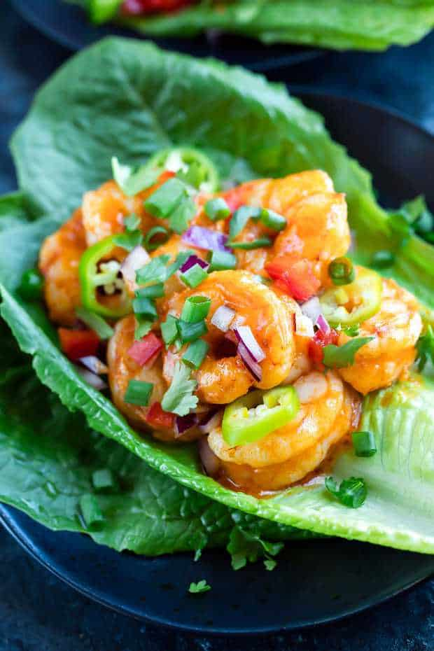 These spicy Buffalo Shrimp Lettuce Wrap Tacos are fast, flavorful, and ready to Taco Tuesday your face off! Each tasty taco is gluten-free, paleo-friendly, and keto friendly too. Woot!
