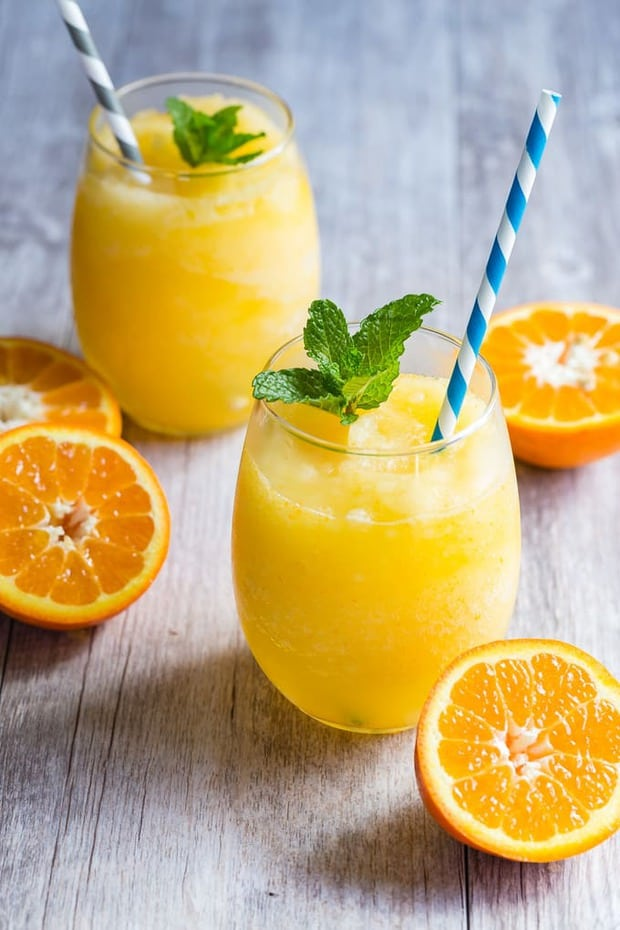 Frozen orange prosecco mixed with freshly squeezed orange juice and blended for a slushy like consistency. This is one easy drink that you have to make this summer!