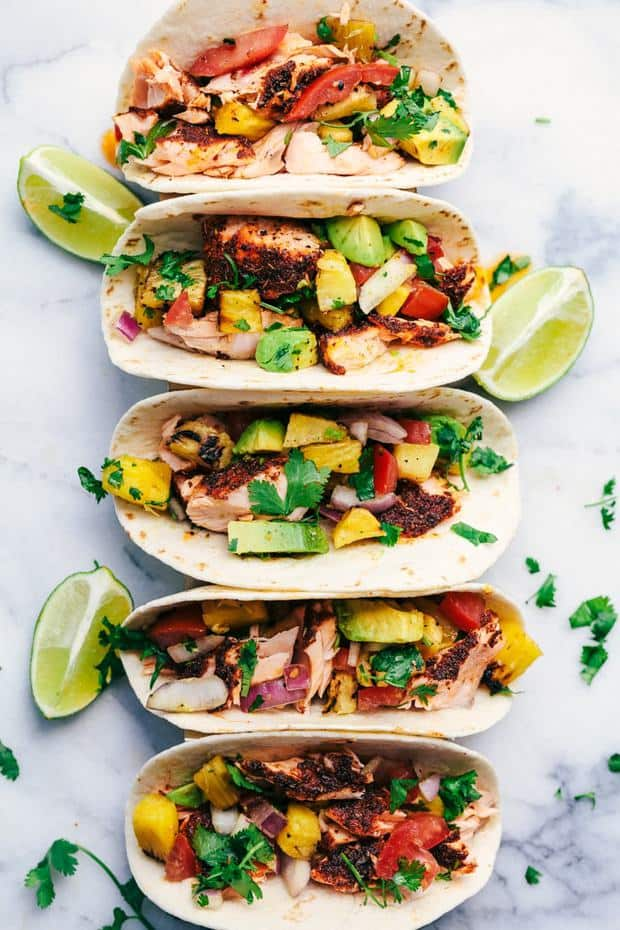Grilled Spicy Blackened Salmon Tacos are grilled to perfection with a delicious spicy crust.  They get topped with a fresh grilled pineapple avocado salsa.  These tacos are fresh and light and the flavors are out of this world!   This is a sponsored conversation written by me on behalf of Salmon Council. The opinions and text are all mine.