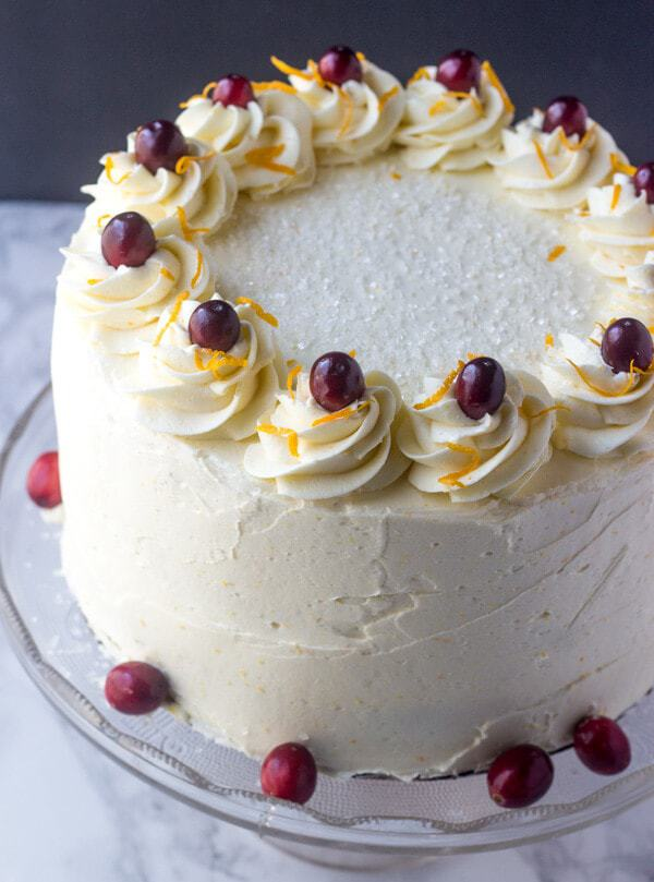 Layered high, this Cranberry Orange Layer Cake is filled with a sweet cranberry filling and frosted with an orange spiked buttercream frosting that will send your tastebuds to heaven.