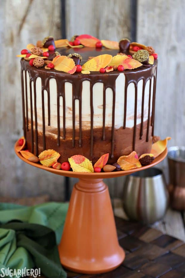 This Festive Fall Layer Cake is the perfect way to celebrate autumn! A rich chocolate cake is filled with a caramel-pecan filling, and topped with gorgeous, edible fall decorations!