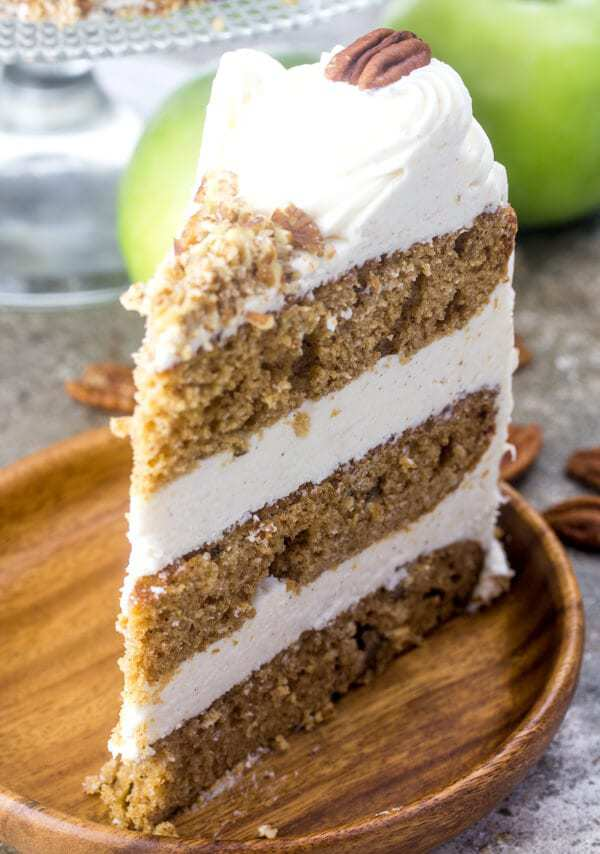 Triple layers of moist goodness this Apple Butter Layer Cake is a fall treat covered and filled with a lightly spiced cinnamon cream cheese frosting and chopped pecans!