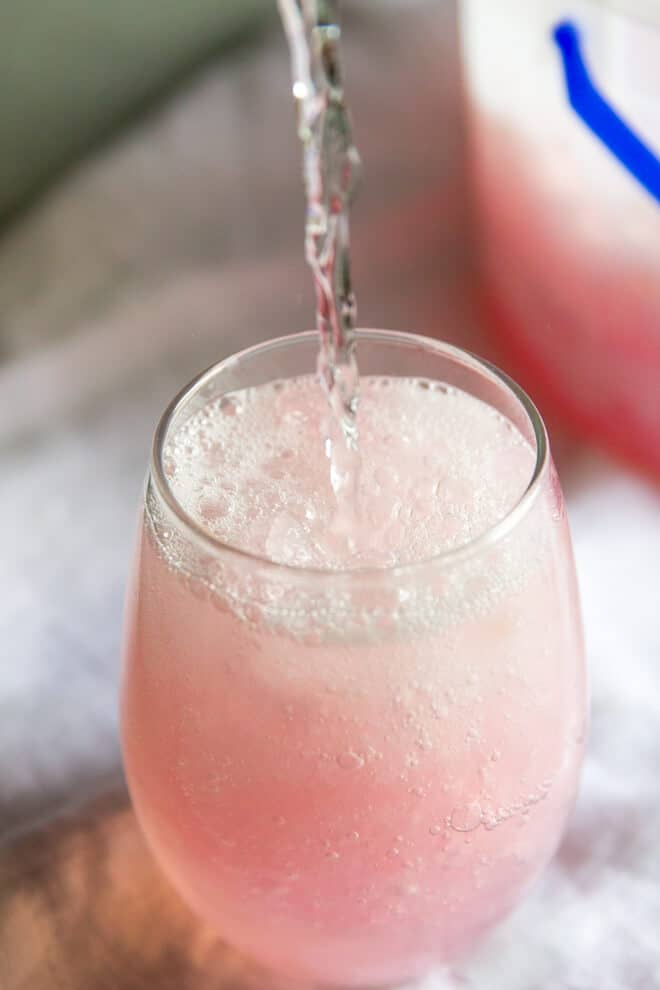 It only takes 3 ingredients to make this easy Pink Lemonade Vodka Slush! This Midwestern classic is great for the holidays, showers, and cocktail parties!