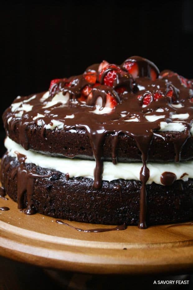 Just in time for Valentine's Day, this decadent layer cake is the perfect way to spoil someone special. Layers of homemade chocolate cake and cheesecake frosting are topped with fresh strawberries and a rich chocolate ganache drizzle.