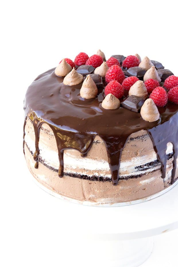 Are you ready for this? We've got four layers of soft chocolate cake, topped with a sweet raspberry sauce and layers of thick, fluffy marshmallow frosting. Then comes rich chocolate buttercream, made with REAL chocolate, and drips of dark chocolate ganache.