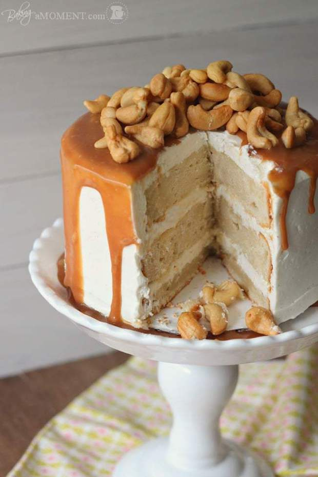 Rich Vanilla Malt Cake, Filled and Frosted with Silky Swiss Meringue Buttercream and Drizzled with Homemade Salted Caramel Sauce.  Roasted Cashews are the Crunchy Crowning Touch!