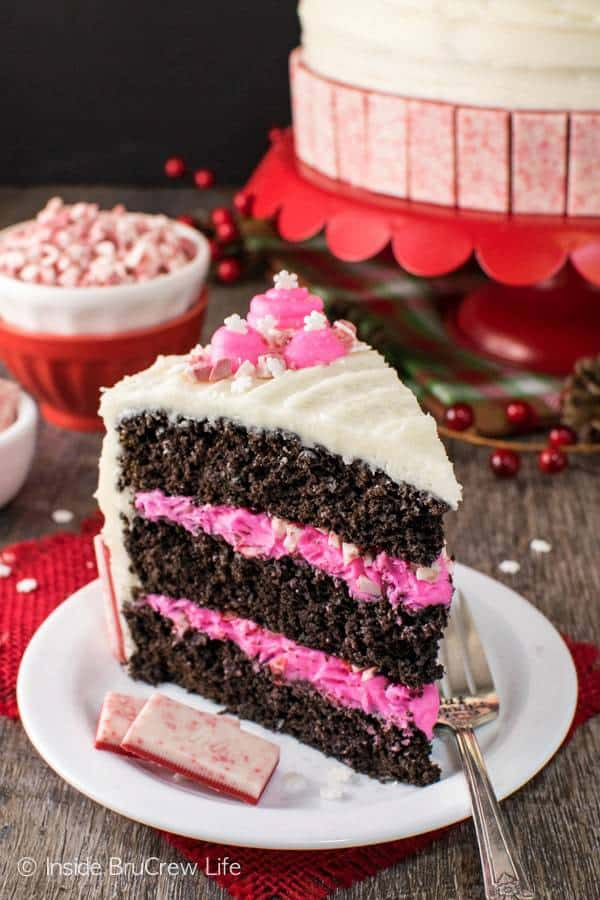 The holidays call for lots of chocolate and peppermint, especially when it looks like this Chocolate Peppermint Layer Cake. Homemade cake with a marshmallow frosting and candies give this sweet treat a holiday flair.