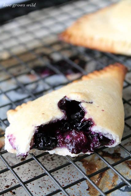 These Blueberries and Cream Hand Pies are incredibly yummy and perfect for traveling! Bake them ahead of time to pack for parties and picnics or enjoy them warm and fresh out of the oven. Either way you will love the fresh blueberry flavor packed into these little pies!