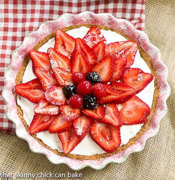When strawberry season hits, it's time to whip up a magnificent berry treat. This Strawberry Cream Cheese Dessert starts with a graham cracker crust, followed by a sweet, creamy filling and finally crowned with fresh, juicy strawberries!