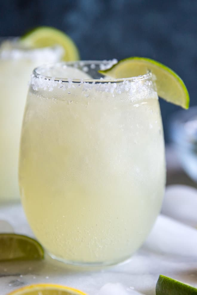 It only takes 4 ingredients to make this easy Margarita Slush! Great for backyard barbecues, pool parties, and summer nights!