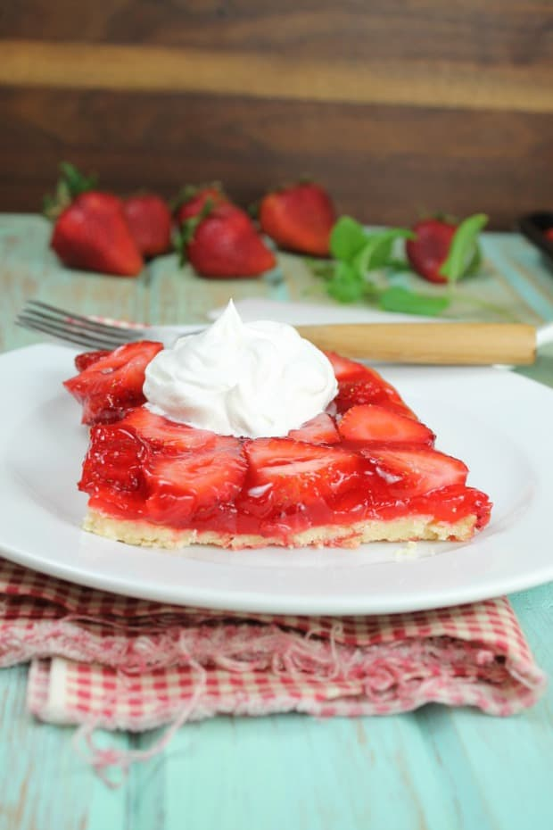 This Strawberry Slab Pie is a spin on my favorite fresh strawberry pie that my grandma made every summer.  A fantastic dessert for any summer get together, barbecue or potluck!