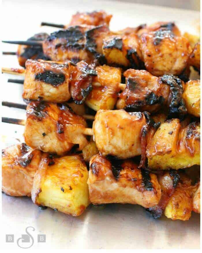These BBQ Chicken Bacon Pineapple Kabobs from Butter with a Side of Bread have tender chicken paired with tangy pineapple and smoky bacon! Slathered with your favorite BBQ sauce, this recipe is sure to become one of your favorite BBQ chicken meals this summer!