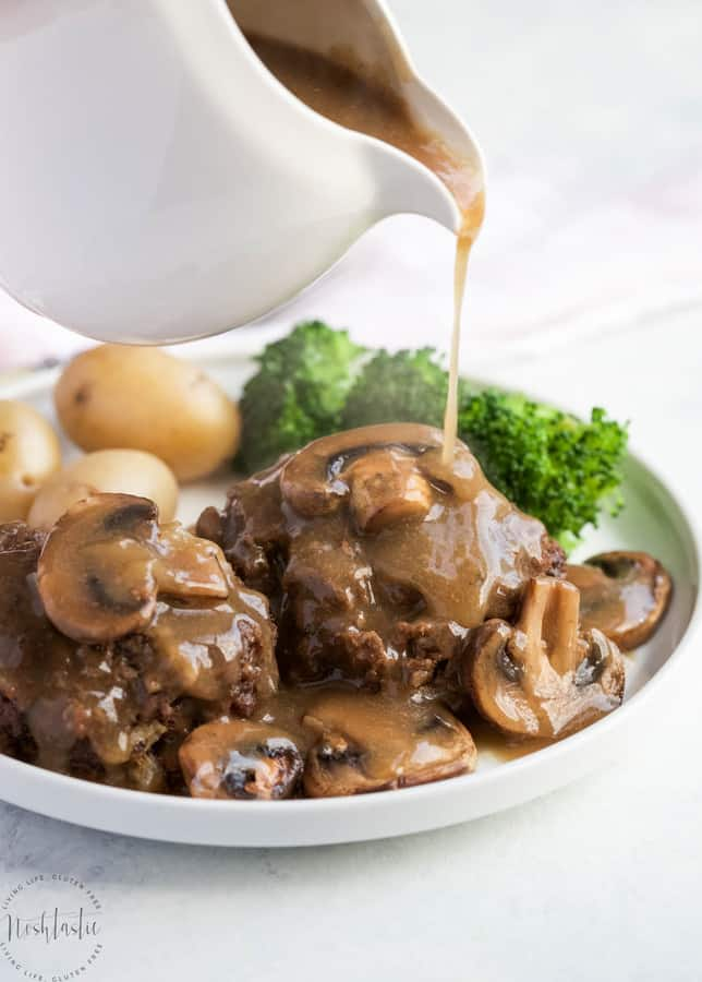 This Instant Pot Salisbury Steak and Gravy is an easy weeknight pressure cooker meal that's gluten free and dairy free! It is lovely served over classic mashed potatoes, rice, or with fresh veggies!