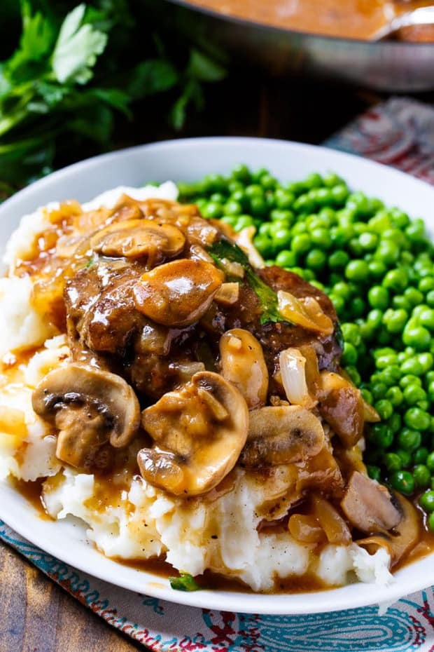 Salisbury Steak covered in a super flavorful gravy loaded with sliced mushrooms and served over mashed potatoes makes a filling and delicious meal
