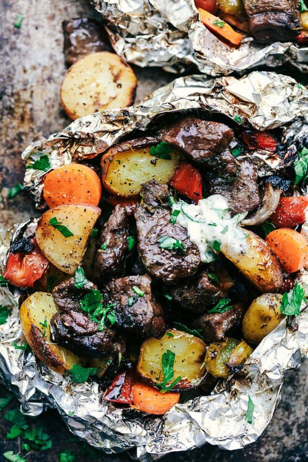 Butter Garlic Herb Steak Foil Packets have melt in your mouth beef with hearty veggies that are grilled to perfection with butter that has garlic and herbs inside. This is one amazing meal that you don't want to miss out on!