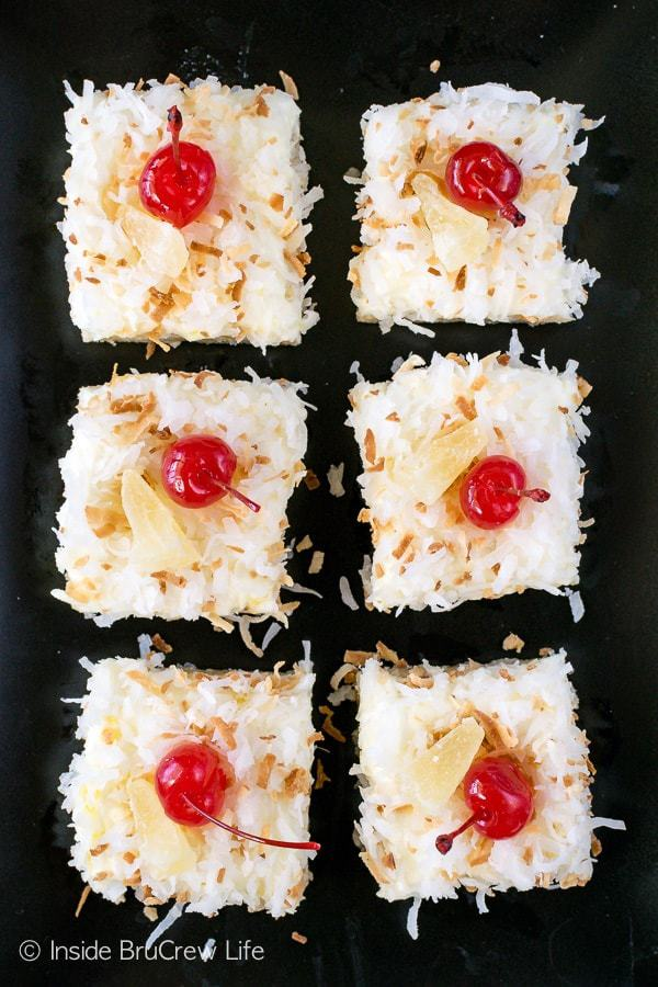 A batch of these tropical Pina Colada Sugar Cookie Bars can be made and frosted in one pan. Make these easy cookie bars for summer parties and picnics.