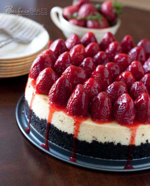 Luscious, creamy New York style cheesecake with a crumbly Oreo cookie crust and topped with fresh strawberries drizzled with a strawberry glaze.